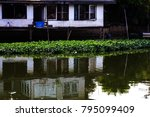 the house on the canal is dirty. | Shutterstock . vector #795099409