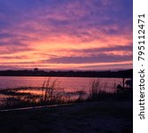 Purple And Pink Sunrise On A...