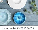 ceramic tableware on wooden