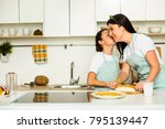happy daughter kissing mother... | Shutterstock . vector #795139447