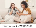 two women listening music... | Shutterstock . vector #795150181
