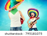 Small photo of Mexican party. Two brothers in sombreros perform on stage, sing serenades.