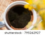 cup of black coffee framed with ... | Shutterstock . vector #795262927