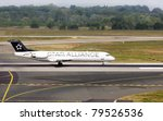 DUSSELDORF, GERMANY - MAY 21: Fokker 100 of ContactAir airlines landed n the Dusseldorf airport on May, 21 2011. Star Alliance is the world's first and largest airline alliance. - stock photo