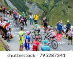 Small photo of Col du Glandon, France - July 24, 2015: A group of four cyclists ,climbing the road to Col du Glandon in Alps, during the stage 19 of Le Tour de France 2015.