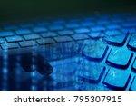 man hand on a laptop keyboard.... | Shutterstock . vector #795307915