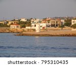 Small photo of Photo of iconic lighthouse in island of Aigina, Saronic gulf, Greece
