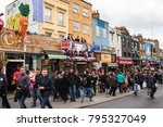 people walking on a very busy... | Shutterstock . vector #795327049