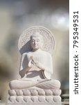 the white stone buddha statue... | Shutterstock . vector #795349531