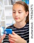 teenager girl with 3d printe.... | Shutterstock . vector #795362971