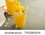 tropical mango smoothie with... | Shutterstock . vector #795385654