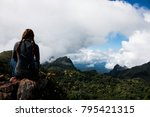 alone traveler and landscape... | Shutterstock . vector #795421315