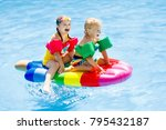 Boy And Girl On Inflatable Ice...