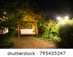 Decoration and furniture hammock with lighting in garden of resort in night time at Pfunds village in Tyrol, Austria - stock photo
