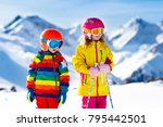 child skiing in the mountains.... | Shutterstock . vector #795442501