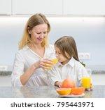 mum is drinking her daughter... | Shutterstock . vector #795443971