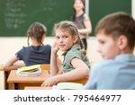 happy schoolchildren sitting at ... | Shutterstock . vector #795464977