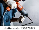 man with electric drill | Shutterstock . vector #795474379