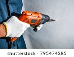 man with electric drill | Shutterstock . vector #795474385