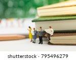 miniature people  sitting on... | Shutterstock . vector #795496279