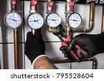 plumber fixing central heating... | Shutterstock . vector #795528604