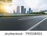 empty asphalt road with city... | Shutterstock . vector #795538501