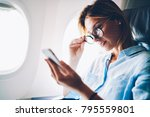 attractive woman traveling by... | Shutterstock . vector #795559801