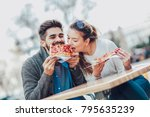 couple eating pizza snack... | Shutterstock . vector #795635239