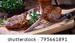 Small photo of Grilled lamb chops an old board
