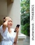 headache young asian woman sit... | Shutterstock . vector #795683821