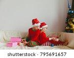 kids opening christmas presents ... | Shutterstock . vector #795691657