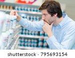 man choosing product in... | Shutterstock . vector #795693154