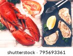 Small photo of Steamed lobster, oysters and shrimps as fine selection of crustacean for dinner
