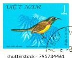 Small photo of Ukraine - circa 2018: A postage stamp printed in Vietnam show bird Green-tailed Sunbird or Aethopyga nipalensis. Series: Birds. Circa 1981.