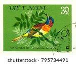 Small photo of Ukraine - circa 2018: A postage stamp printed in Vietnam show Black-throated Sunbird or Aethopyga saturata. Series: Birds. Circa 1981.