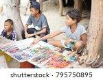 the moken kids is selling... | Shutterstock . vector #795750895