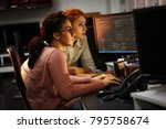 Two female programmers working...