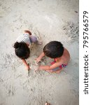 happy asian child playing sand... | Shutterstock . vector #795766579