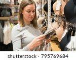 woman choosing bra in clothing...   Shutterstock . vector #795769684