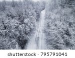 aerial view of snowy forest... | Shutterstock . vector #795791041