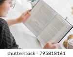 a hipsters girl reads a book in ... | Shutterstock . vector #795818161