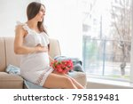 beautiful pregnant woman with... | Shutterstock . vector #795819481