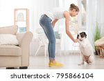 woman with cute white boxer dog ... | Shutterstock . vector #795866104