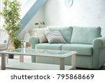 comfortable sofa with pillows... | Shutterstock . vector #795868669