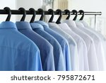 clean shirts hanging on rack in ... | Shutterstock . vector #795872671