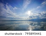 Small photo of wonderful reflexion mirror between sky, cloud, sunshine and sea, representative like paradise or heaven on eath., Thailand.