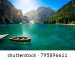 Small photo of amazing view of braies lake with wooden boats on the water, surrounded by dolomites mountains. Trentino alto adige, Italy on the water, surrounded by dolomites mountains. Trentino alto adige, Italy