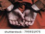 hands of the girl in handcuffs. ... | Shutterstock . vector #795931975