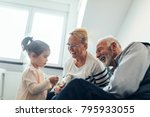 grandparents spending time with ... | Shutterstock . vector #795933055