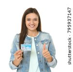 young woman holding driving... | Shutterstock . vector #795937147